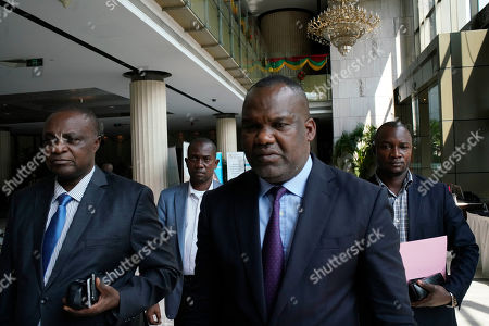 Corneille Nangaa, the president of the independent electoral commission (CENI), centre, arrives at a meeting with SADC members and presidential candidates in Kinshasa, Congo, . Congolese people are heading to the polls Sunday Dec. 30 for a presidential race that has been plagued by years of delay and persistent rumours of lack of preparation