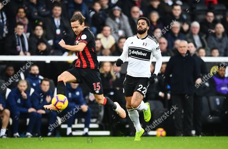Chris Lowe of Huddersfield Town defends under pressure from Cyrus Christie of Fulham