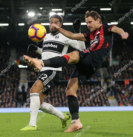 Chris Lowe  of Huddersfield and  Cyrus Christie of Fulham