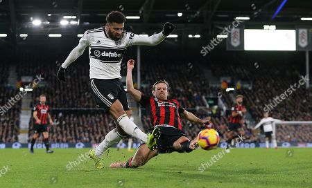 Chris Lowe  of Huddersfield tries to block  Cyrus Christie of Fulham pass
