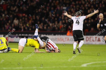 Sheffield United midfielder John Fleck (4) appeals to the referee Anthony Taylor  after Blackburn Rovers midfielder Richard Smallwood (6) tackles Sheffield United forward Billy Sharp (10) during the EFL Sky Bet Championship match between Sheffield United and Blackburn Rovers at Bramall Lane, Sheffield