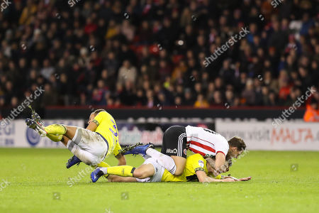 Blackburn Rovers midfielder Richard Smallwood (6) tackle on Sheffield United forward Billy Sharp (10) results in a red card for the Blackburn Rovers player during the EFL Sky Bet Championship match between Sheffield United and Blackburn Rovers at Bramall Lane, Sheffield