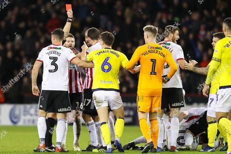Blackburn Rovers midfielder Richard Smallwood (6) and Sheffield United midfielder Ollie Norwood (16) exchange views after Blackburn Rovers midfielder Richard Smallwood (6) is sent off during the EFL Sky Bet Championship match between Sheffield United and Blackburn Rovers at Bramall Lane, Sheffield
