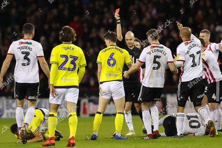 Blackburn Rovers midfielder Richard Smallwood (6) is shown a red card by the referee Anthony Taylor during the EFL Sky Bet Championship match between Sheffield United and Blackburn Rovers at Bramall Lane, Sheffield