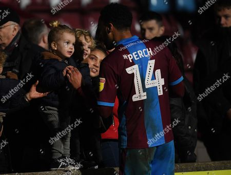James Perch of Scunthorpe United greets children at full time