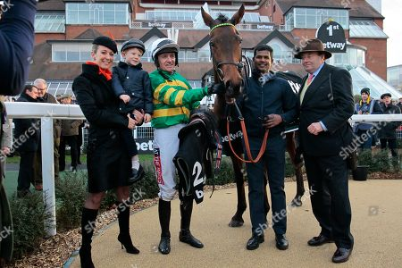 Stock Picture of Champ named after Sir Anthony McCoy [absent] with Lady Chanelle McCoy, Barry Geraghty and Nicky Henderson after victory in the Betway Challow Novices' Hurdle at Newbury.