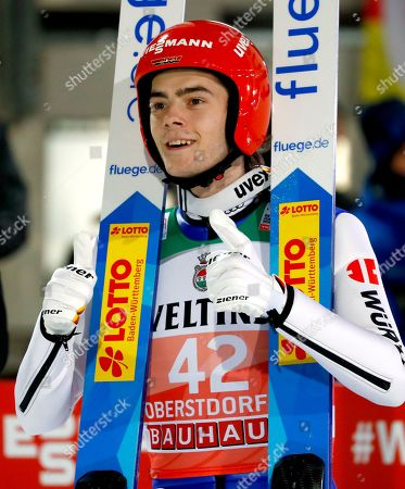 Germany's David Siegel gestures after a qualification jump at the first stage of the 67th four hills ski jumping tournament in Oberstdorf, Germany