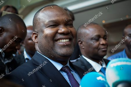 President of the DR Congo's electoral commission the Commission Electorale Nationale Independante (CENI) Corneille Nangaa smiles as he speaks to the media after meeting with the three Presidential candidates, the ruling party candidate Emmanuel Ramazani Shadary, joint opposition candidate Martin Fayulu and Felix Tshisekedi, the leader of the Union for Democracy and Social Progress (UDPS) party in Kinshasa, Democratic Republic of the Congo, 29 December 2018. DR Congo is going to the polls on 30 December 2018 after postponing polls in three regions citing ebola crisis and insecurity.