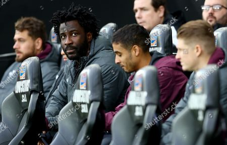 Wilfried Bony of Swansea City on the substitutes bench