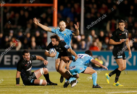 Marcelo Bosch of Saracens is tackled by Jonny Arr of Worcester