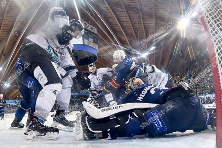 Magnitogorsk's Pavel Nechistovsky performs a safe during the game between HK Metallurg Magnitogorsk and Thomas Sabo Ice Tigers, at the 92th Spengler Cup ice hockey tournament in Davos, Switzerland, 29 December 2018.