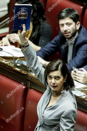 Former President of the Chambre, Laura Boldrini, holds a copy of the Italian Constitution during the vote of confidence on the budget law in the Chambre of Deputies in Rome, Italy, 29 December 2018. Chamber President Fico suspended the session for five minutes after Forza Italia deputies wore blue bibs with inscriptions such as 'Down the Hands of No Profit' and 'No Taxes'.