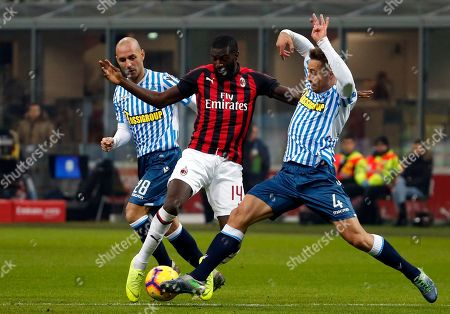 AC Milan's Tiemoue Bakayoko vies for the ball with Spal's Thiago Cionek, right, during a Serie A soccer match between AC Milan and Spal, at the San Siro stadium