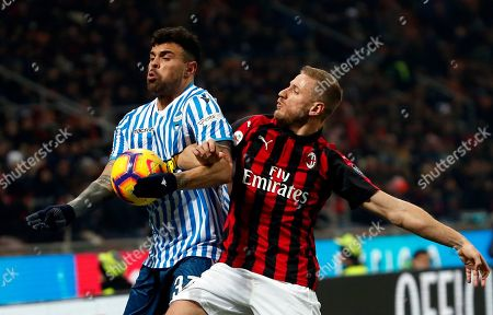 Spal's Andrea Petagna fights for the ball with AC Milan's Ignazio Abate, right, during a Serie A soccer match between AC Milan and Spal, at the San Siro stadium