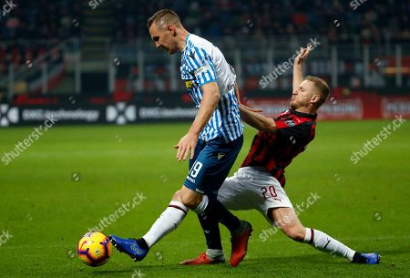 AC Milan's Ignazio Abate, right, vies for the ball with Spal's Jasmin Kurtic during a Serie A soccer match between AC Milan and Spal, at the San Siro stadium