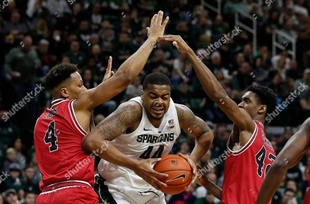 Lacey James, Nick Ward, Levi Bradley. Michigan State forward Nick Ward (44) is double teamed by Northern Illinois forwards Lacey James (4) and Levi Bradley (42) during the second half of an NCAA college basketball game, in East Lansing, Mich