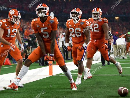 Tee Higgins, Hunter Renfrow, Adam Choice, John Boyd. Clemson wide receiver Tee Higgins (5) celebrates his touchdown catch with wide receiver Hunter Renfrow (13), running back Adam Choice (26) and linebacker John Boyd (46) in the first half of the NCAA Cotton Bowl semi-final playoff football game against Notre Dame, in Arlington, Texas