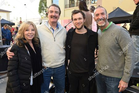"""Dole Packaged Foods' """"Let Sunshine In, Drive Hunger Out"""" spokesperson Phillip Phillips poses with Dole Packaged Foods' President Brad Bartlett and his wife Dottie and VP of Marketing Dave Spare at Live on Green! on in Pasadena, Calif"""