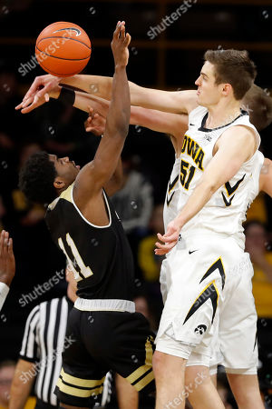 Adam Grant, Nicholas Baer. Iowa forward Nicholas Baer blocks a shot by Bryant guard Adam Grant (11) during the second half of an NCAA college basketball game, in Iowa City, Iowa. Iowa won 72-67