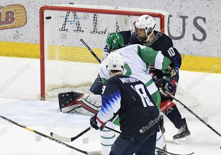 North Dakota Fighting Hawks forward Casey Johnson (5) scores a goal as US National Under 18 team defenseman Marshall Warren (10) looks on during a exhibition men's college hockey game between the U.S. National Under-18 team and the University of North Dakota Fighting Hawks at Ralph Engelstad Arena in Grand Forks, ND. UND won 6-2