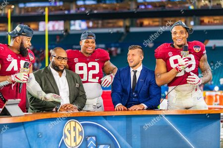 Alabama Crimson Tide defensive lineman Quinnen Williams (92) and Alabama Crimson Tide defensive lineman Raekwon Davis (99) and Tim Tebow on set after the Capital One Orange Bowl NCAA College Football Playoff game between Alabama and Oklahoma on at Hard Rock Stadium in Miami Gardens, FL