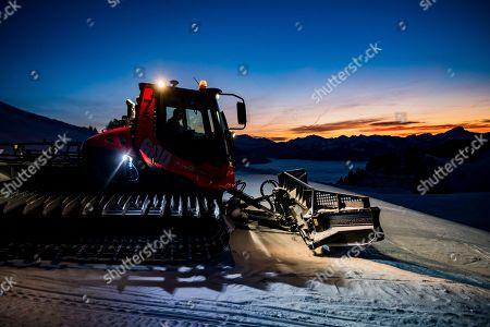Stock Photo of Adrien Jaggy and his snow groomer prepare the ski slopes of the ski area Tele Villars-Gryon-Les-Diablerets (TVGD), in Villars-sur-Ollon, Switzerland, 29 December 2018 (issued 30 December 2018).