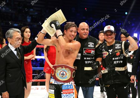 Japanese champion Masayuki Ito celebrates after defeating Russian challenger Evgeny Chuprakov in the seventh round of their WBO junior lightweight world boxing title match in Tokyo, . Ito defended his title with a technical knockout