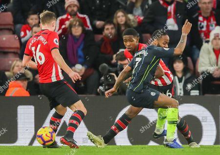 Kayne Ramsay of Southampton tackles Raheem Sterling of Manchester City
