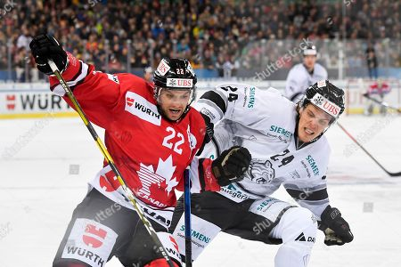 Team Canada's Zach Boychuk (L) and Ice Tigers's Marcus Weber fight for the puck during the game between Team Canada and Thomas Sabo Ice Tigers at the 92th Spengler Cup ice hockey tournament in Davos, Switzerland, 30 December 2018.