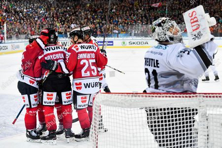 Team Canada celebrates after Zach Boychuk scored the 2-0 during the game between Team Canada and Thomas Sabo Ice Tigers at the 92th Spengler Cup ice hockey tournament in Davos, Switzerland, 30 December 2018.
