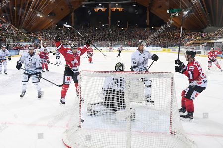 Team Canada's Zach Boychuk (L) and Team Canada's Cory Emmerton (R) celebrate after Boychuk scored the 2-0 versus Ice Tigers's Niklas Treutle (C) during the game between Team Canada and Thomas Sabo Ice Tigers at the 92th Spengler Cup ice hockey tournament in Davos, Switzerland, 30 December 2018.