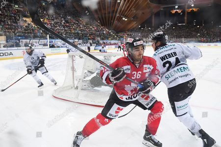 Team Canada's Matt D'Agostini (L) fights for the puck with Ice Tigers' Marcus Weber during the game between Team Canada and Thomas Sabo Ice Tigers at the 92th Spengler Cup ice hockey tournament in Davos, Switzerland, 30 December 2018.