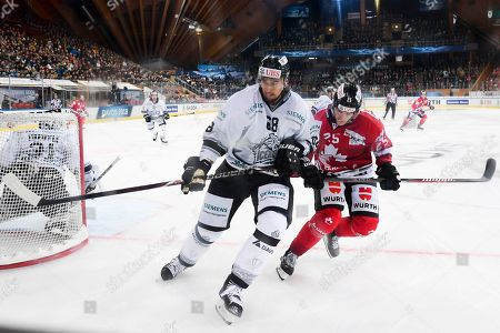 Ice Tigers's Milan Jurcina (L) and Team Canada's Cory Emmerton fight for the puck during the game between Team Canada and Thomas Sabo Ice Tigers at the 92th Spengler Cup ice hockey tournament in Davos, Switzerland, 30 December 2018.