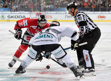 Team Canada's Daniel Winnik (L) and Ice Tigers's Chris Brown during a bully at the game between Team Canada and Thomas Sabo Ice Tigers at the 92nd Spengler Cup ice hockey tournament in Davos, Switzerland, 30 December 2018.