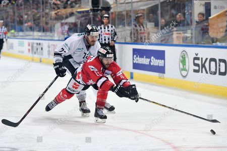 Team Canada's Andrew Ebbet, right, and Ice Tiger's Mike Mieszkowski fight for the puck during the game between Team Canada and Thomas Sabo Ice Tigers at the 92nd Spengler Cup ice hockey tournament in Davos, Switzerland, 30 December 2018.