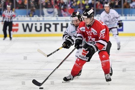 Team Canada's Cory Emmerton, right, and Ice Tigers's Daniel Weiss, fight for the puck during the game between Team Canada and Thomas Sabo Ice Tigers at the 92nd Spengler Cup ice hockey tournament in Davos, Switzerland, 30 December 2018.