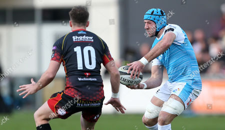 Justin Tipuric of Ospreys is challenged by Josh Lewis of Dragons.