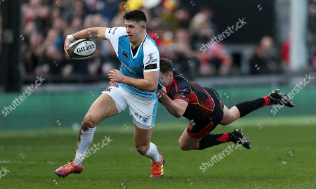 Owen Watkin of Ospreys is tackled by Josh Lewis of Dragons.