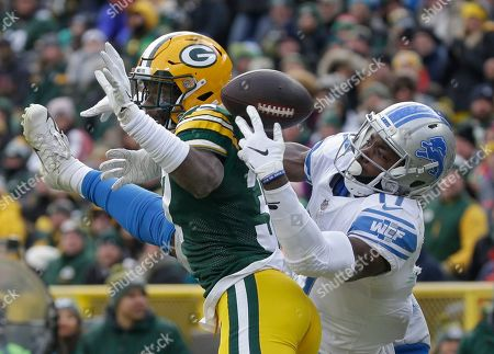 Green Bay Packers' Josh Jackson breaks up a pass intended for Detroit Lions' Andy Jones during the second half of an NFL football game, in Green Bay, Wis
