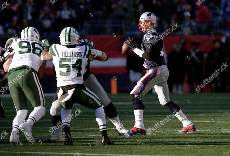 New England Patriots quarterback Tom Brady, right, drops back to pass under pressure from New York Jets defenders Henry Anderson (96) and Avery Williamson (54) during the first half of an NFL football game, in Foxborough, Mass