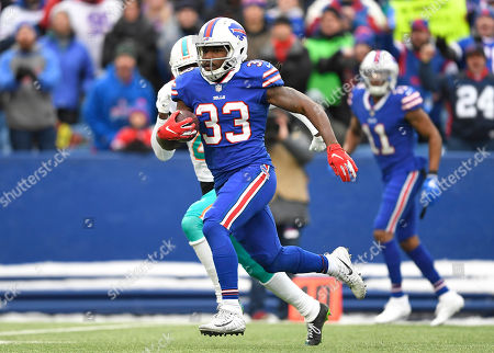 Stock Photo of Buffalo Bills running back Chris Ivory (33) rushes during the first half of an NFL football game against the Miami Dolphins, in Orchard Park, N.Y