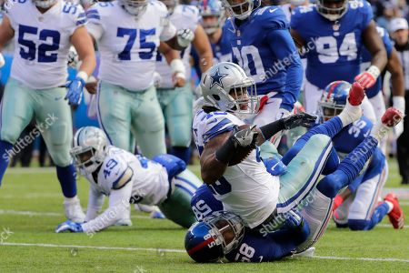 Dallas Cowboys' Rod Smith, right, is tackled by New York Giants' Tae Davis during the first half of an NFL football game Sunday, Dec., 30, 2018, in East Rutherford, N.J