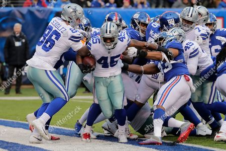 Dallas Cowboys' Rod Smith (45) scores a touchdown during the second half of an NFL football game against the New York Giants, in East Rutherford, N.J