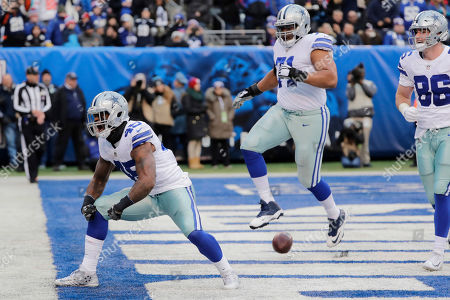 Dallas Cowboys' Rod Smith (45), left, reacts after scoring a touchdown during the second half of an NFL football game against the New York Giants, in East Rutherford, N.J