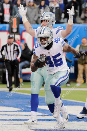Dallas Cowboys' Rod Smith (45) reacts after scoring a touchdown during the second half of an NFL football game against the New York Giants, in East Rutherford, N.J