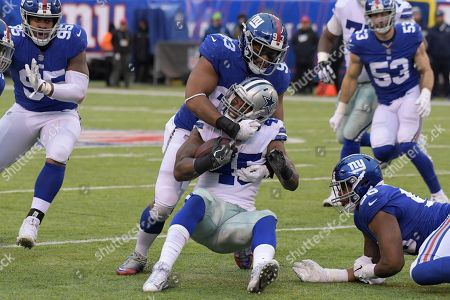 Dallas Cowboys' Rod Smith, bottom center, is tackled by New York Giants' B.J. Goodson during the second half of an NFL football game, in East Rutherford, N.J