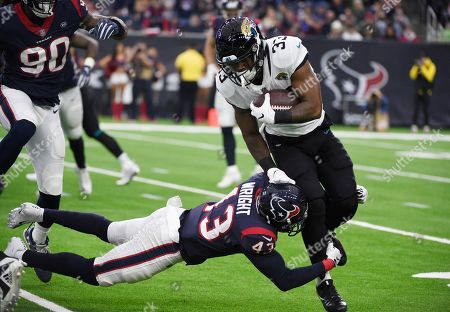 Stock Picture of David Williams, Shareece Wright. Jacksonville Jaguars running back David Williams (33) is hit by Houston Texans defensive back Shareece Wright (43) during the first half of an NFL football game, in Houston