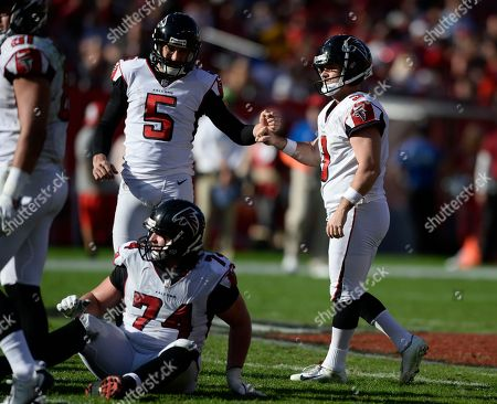 Atlanta Falcons' Matt Bosher (5) celebrates with kicker Matt Bryant (3) after a field goal against the Tampa Bay Buccaneers during the second half of an NFL football game, in Tampa, Fla
