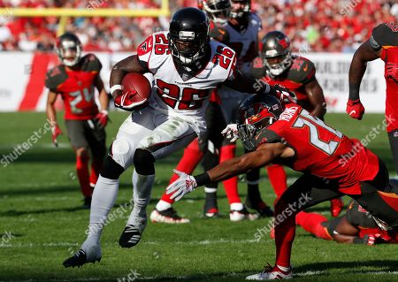 Atlanta Falcons running back Tevin Coleman (26) runs past Tampa Bay Buccaneers defensive back Andrew Adams (26) for a touchdown during the second half of an NFL football game, in Tampa, Fla