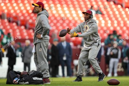 Stock Photo of Washington Redskins quarterback Mark Sanchez, left, and Washington Redskins quarterback Josh Johnson, right, during warmups before an NFL football game against the Philadelphia Eagles, in Landover, Md. The Eagles defeated the Redskins 24-0